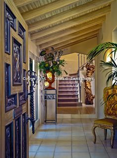 Interior Design, decor designers front entry foyer.  The front door is intricate and the hallways beyond is simple by elegant.
