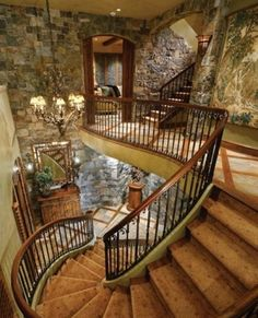 Rock walls, grand staircase in this log home
