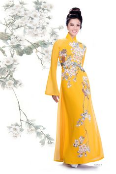 Long sleeves, high neck, and an ankle-length dress - who could ask for more! The yellow burst of sunshine and flower blossom designs will even get a grinch in Eid spirit! - Habiba West