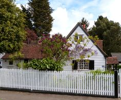 Stanmore, UK. Weatherboarded cottage in Green Lane