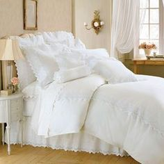 Transform your master suite or guest bedroom into a hotel-chic retreat with the romantic Campagne Duvet. Highlighted by delicate scalloped details, this luxe cotton design inspires Sunday morning sleep-ins and indulgent breakfasts in bed.     Product: Duvet cover    Collection: Campagne        Construction Material:  100% Cotton  Color: White    Cleaning Instructions: Machine wash gentle. Tumble dry low.