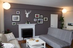"""Grey feature wall with white """"deer"""" head. Great balance between cozy and modern."""