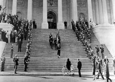 Jacqueline Kennedy escorts her children, Caroline and John, Jr. up the steps of the Capitol. They are following the casket of assassinated President John Kennedy. Other members of the Kennedy family, led by Robert Kennedy are behind. Nov. 24, 1963.