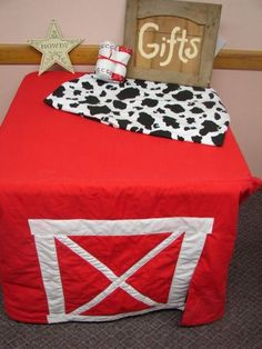 Love this gift table idea for barnyard birthday party.  See more farm and birthday parties for kids on www.one-stop-party-ideas.com