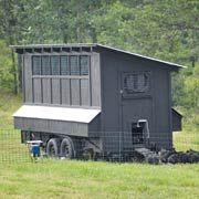 """Mobile Chicken House-moving fertilizer but control  This building falls under the category of """"work with what you have"""" because it is built on top of an old boat trailer."""