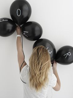 Write one letter (in white) per (black) balloon for a cool banner look.