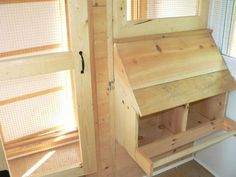 View of nest boxes & screen door (opens INTO coop) from coop side.raised up a bit from floor level to keep bedding inside coop (see link) Large Chicken Coop Plans, Chicken Nesting Boxes, Duck Coop, Raising Chickens, Chickens Backyard, Coops, Play Houses, Farm Life, Floor Plans