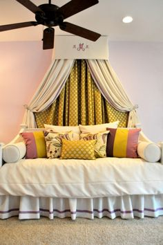A solid color canopy with curtains under it with a print.  Would look great around a crib, bed or glider
