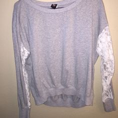Lace Cut-Out Sweater Grey sweater with lace cutout in the sleeves! Putting a spin on the regular everyday sweat top  Sweaters Crew & Scoop Necks