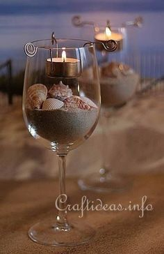 DIY Beach wine glass candle holders wedding favor/ table centerpieces all in one. one for each guest & possibly monogram the glass with a simple DIY project! Wine Glass Candle Holder, Votive Holder, Glass Votive, Mini Terrarium, Do It Yourself Wedding, Ideas Geniales, Seashell Crafts, Seashell Art, Beach Crafts
