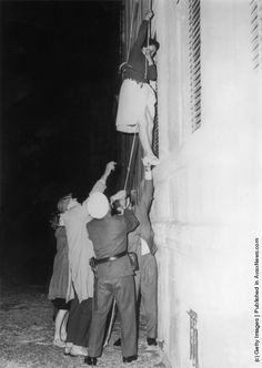 A woman is lowered from a window in Bernauer Strasse on a rope to escape into the western sector of #Berlin after the post-war division of the city. (Photo by Keystone/Getty Images). 10th September 1961