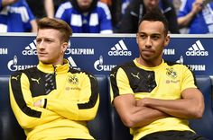 Pierre- Emerick Aubameyang Photos Photos - Marco Reus and Pierre-Emerick Aubameyang of Borussia Dortmund look on from the bench before the Bundesliga match between FC Schalke 04 and Borussia Dortmund at Veltins-Arena on April 10, 2016 in Gelsenkirchen, Germany. - FC Schalke 04 v Borussia Dortmund - Bundesliga