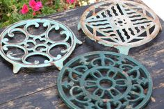 """IMG_7777.JPG French Trivet Green Variety  $51.00  Metal trivet from the 1930's, with beautiful scroll detailing. Perfect for hot pots, pans, teapots. All original paint. Measures 7"""" diameter. One available as shown from list below; sold individually. France, circa 1930."""