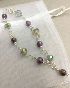 Ametheyst and Bead Bracelet with Amethyst charm by Jewelrybyila