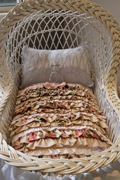 Hand Quilted Blanket in a Bassinet