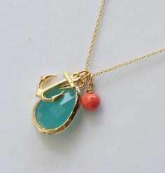 Mint Gold Framed Glass, Anchor Pendant and coral bead Necklace by PinkforYou on Etsy https://www.etsy.com/listing/105394559/mint-gold-framed-glass-anchor-pendant