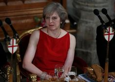 Britain's Prime Minister, Theresa May listens to a speech at the Lord Mayor's Banquet, at the Guildhall, London, Britain November REUTERS/Peter Nicholls Theresa May, Britain, Tank Man, Prime Minister, Mens Tops, Banquet, November, Lord, November Born