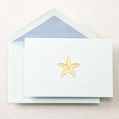 Open this shimmering aqua envelope to reveal a beautiful hand engraved gold starfish note - bringing to mind a day spent at the beach, barefoot and warm, collecting rare sea treasures.