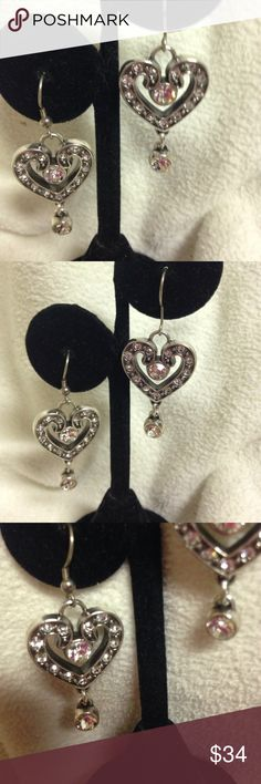 Gorgeous or of Brighton French wire drop earrings This is one of Brighton's best! Undeniably stunning with light capturing fire coming from the genuine Swarovski crystals. The detail is undeniable ! Measures 1 3/4 inch drop and 3:4 inch width. Silver plated. Please see all my other wonderful Brighton items on sale and let me Bundle you! Brighton Jewelry Earrings