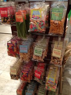 The snacks at the Library of Congress shop, proving no librarian anywhere can resist a pun. Stacks Snack, Literary Twists, Book Worms, Metaphor Mix, Biblio Bears, Fruits of Knowledge, Book Nuts, Capitol Crunch.