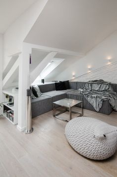 gorgeous grey living room at a renovated attic apartment in Prague by OOOOX OOOOX handled the renovation of an attic apartment located in the Czech Republic that features a loft, sloped ceilings, and soothing grey and white colors. Attic Bedroom Designs, Attic Design, Living Room Designs, Interior Design, Interior Ideas, Interior Architecture, Bedroom Ideas, Attic House, Attic Loft