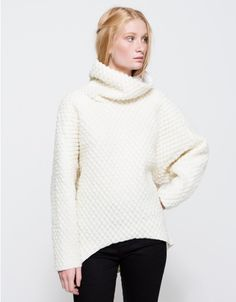 From Margaux Lonnberg, a cozy knit sweater with modern styling in White.  Features tall neckline, slouchy neckline, wide sleeves, gusset sleeves, finished edges, tapered hem, high-low hem, rounded hem, fully lined and relaxed fit.  •Knit sweater in Whi