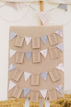 Hessian table plan with mini bunting & kraft paper / http://www.deerpearlflowers.com/unique-bunting-wedding-ideas/2/