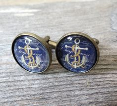 Anchor Cufflinks - Nautical Cufflinks For Men - Men's Jewelry - Men's Accessories - Gift For Men's - Groomsman Gift  These cufflinks features an anchor.  The image is printed on high-quality photo paper and protected with high-gloss epoxy resin, set in antique bronze cufflinks.  Cacochon size: 18 mm (about 0.7 inches) . $22