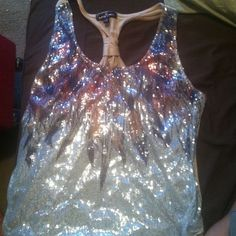 Sparkly Racer back Sparkly racer back top, worn twice, very stretchy. 1x $7 PP 65% polyester 35% rayon Tops