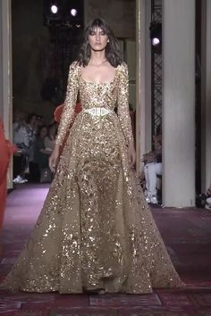 Zuhair Murad Look Fall Winter Couture Collection Stunning Embroidered Golden Sheath Evening Maxi Dress / Evening Gown with Deep Neck Cut, Long Sleeves, Princes Skirt and a Train. Runway Show by Zuhair Murad Zuhair Murad, Couture Dresses, Bridal Dresses, Fashion Dresses, Prom Dresses, Beautiful Gowns, Beautiful Outfits, Stunning Dresses, Elegant Dresses