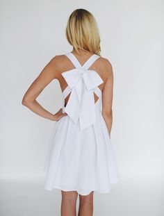 White Lauren James Searsucker dress  cross back with large bow detail
