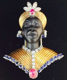 1950s Ruby Sapphire Diamond Gold Blackamoor Brooch | From a unique collection of vintage brooches at http://www.1stdibs.com/jewelry/brooches/brooches/