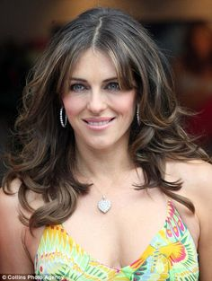 Is grey-haired Elizabeth Hurley finally ready to grow old gracefully?