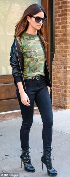 Cool in camouflage: Lily Aldridge looked chic in her leather boots and black jeans
