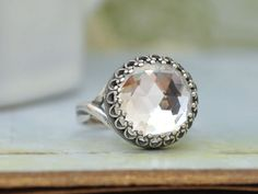 VINTAGE SPARKLES antique silver ring with vintage  Swarovski crystal cab. $22.50, via Etsy.