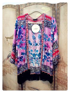 this kimono has frills down the bottom which i really like, it also uses bright colours which blend well together.