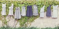 Love these mismatched bridesmaids dresses in shades of blue and grey