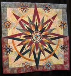 Moral Compass -- Rachel Weltzler. Love the straight line background quilting