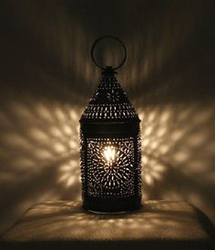 Unique lighting patterns - the 18th century look from a punched tin  lantern.