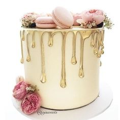 Wow! Gorgeous drip cake with macarons.