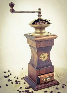 Antique hand crank coffee mill grinder with wooden base, hopper and drawer. The form is internationally known as a form. Coffee Tasting, Coffee Drinks, Coffee Cups, Coffee Maker, Coffee Coffee, Coffee World, Uses For Coffee Grounds, Espresso Shot, Black Coffee Tables