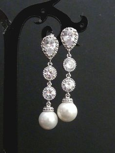 1fce184b1a This earring features a white round Swarovski crystal pearl