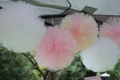 Puffy, pretty, tulle poms...someday I'll decorate the trees in the backyard with poms like these for just the right event -- shower or girl party!