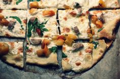 sausage and peach pizza with basil