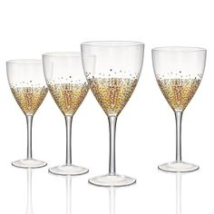 Drinking wine is an instant celebration with the Artland Ambrosia Wine Glass - Set of 4 . This set includes four handmade wine glasses decorated with. Casual Table Settings, Decorated Wine Glasses, Wine Glass Set, Glass Bottle, Wine Bottles, Glass Jars, Gold Confetti, Great Housewarming Gifts, Safe Food