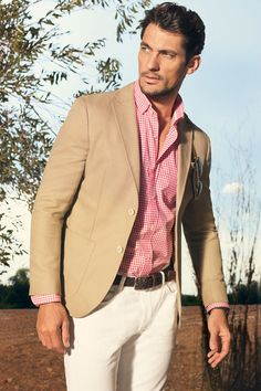 For a man who would like to experiment with color but would like to keep it safe, this outfit from Massimo Dutti would be a good start.    A tan blazer with cream pants would tone down the salmon pink shirt - masculine with a touch of adventure.