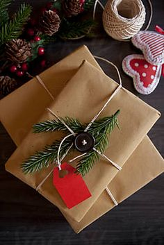 Christmas gifts with red tag by Nataša Mandić - Stocksy United Christmas Gift Wrapping, Christmas Gifts, Lets Celebrate, Design Elements, Royalty Free Stock Photos, Greeting Cards, Wraps, Presents, Woman Drawing