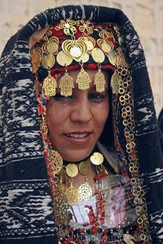 """Source: Ethnic Jewelry and Adornment FB page: """"Tunisia, Sahara, Tozeur, 'Head And Shoulders Portrait Of Tunisian Bride Wearing Traditional Dress, Gold Jewelry And Decorated Head Dress In Preparation For Her Wedding Held On The Edge Of The Sahara Desert.'- See more at: http://www.superstock.com/stock-photos-images/1850-25330#sthash.JNELfXl2.dpuf"""""""