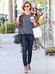 Star Tracks: Friday, August 15, 2014 | TALKING SHOP   | With a cup of coffee, shopping bag and one very cool cover-up, Lily Collins keeps it real on a walk through Beverly Hills on Thursday.