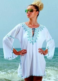 Medina Sequin Kaftan - White & Blue - £80 - Sizes S-XL  Medina Crinkle Cotton kaftan is available in a variety of colours and 3 different lengths. Multi Coloured sequins on the hand embroidery makes the Medina kaftan the perfect cover-up, as the colours match any swimwear. The Medina Beach Kaftan has 3/4 length sleeves and side splits. It is perfect over a swimsuit or bikini on the beach or belted over trousers in the day or evening. www.myabluebeach.com